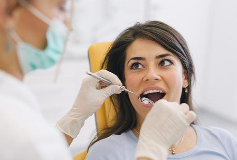 Woman in dental chair during tooth extraction