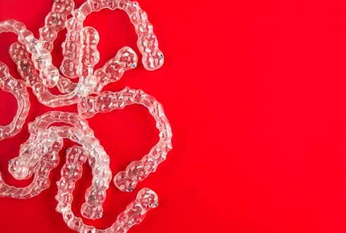 Invisalign aligners on red background