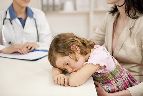 Child falling asleep at dentist's office